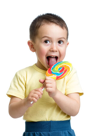 sweet smile: kid boy eating lollipop isolated