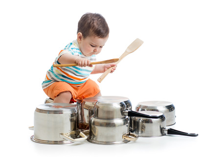 playing with spoon: kid boy drumming playing with pots