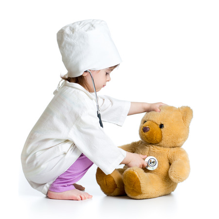 kid girl playing doctor with toy photo