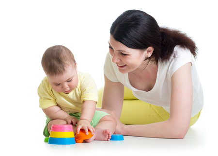 child and mother play together with cup toys photo
