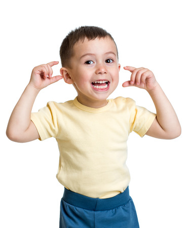 mimic: kid boy making funny faces Stock Photo