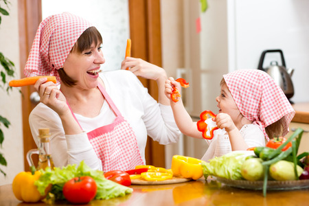 woman and kid girl cooking and having fun photo