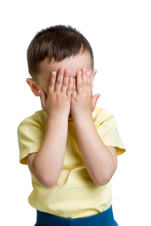 little boy closed eyes with his hands photo