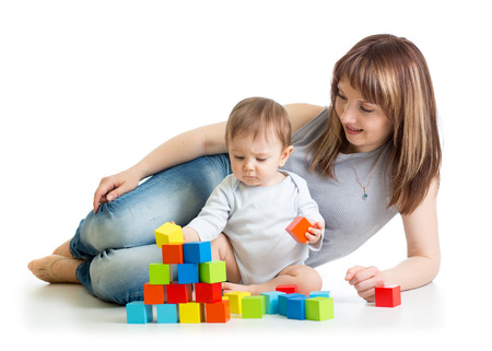 baby boy and his mom play with building blocks photo