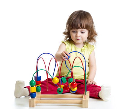 pretty kid with educational toy photo