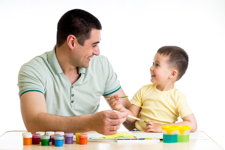 happy kid and dad paint together photo