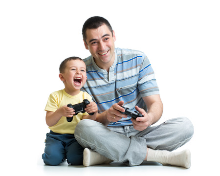 man and his son child play with a playstation together photo