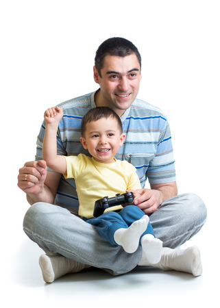remote controls: child boy and his father play with a games together Stock Photo