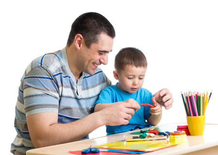 Happy father and child boy play clay together Stock Photo