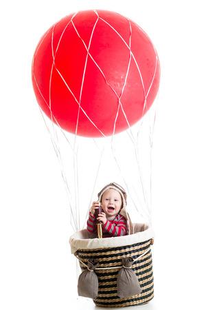 cheerful kid on hot air balloon photo