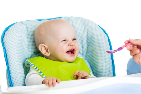 smiling baby eating food photo