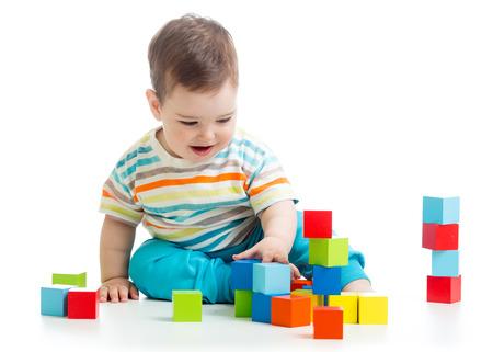 assiduous: toddler boy building block toys Stock Photo