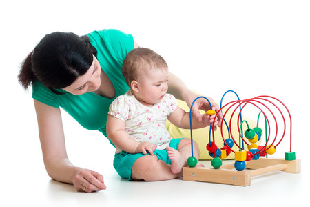 child and mother play with color educational toy photo