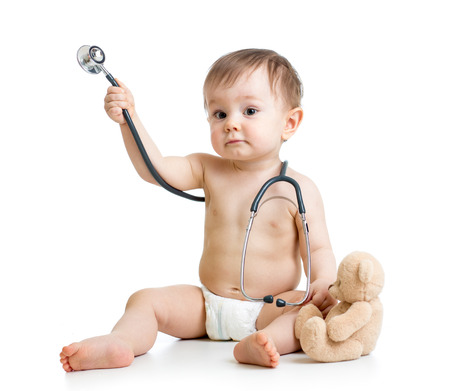 funny baby boy weared diaper with stethoscope photo