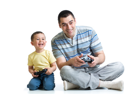 man and his son play with a video game together photo