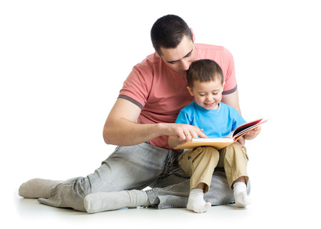 father reading a book to kid photo