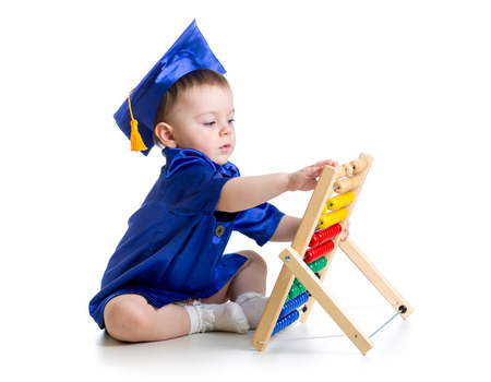 baby with academic clothes playing abacus photo