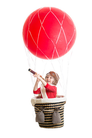 child on hot air balloon watching through spyglass photo