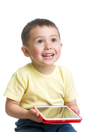 smiling child playing pc tablet photo