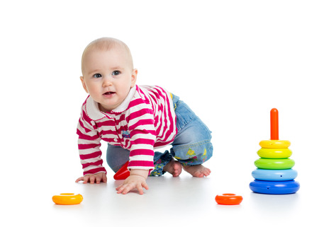 baby boy playing with educational toy photo