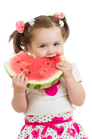 Kid girl eating watermelon isolated on white photo