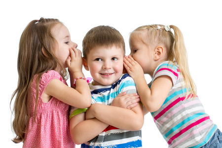 kids girls sharing a secret with child boy isolated photo