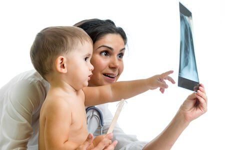 roentgenogram: Doctor and kid reviewing radiograph