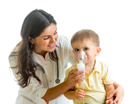 stenosis: Doctor holding inhaler mask for kid breathing, hospital
