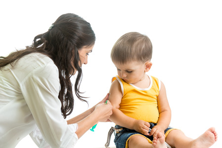 vaccinating: doctor vaccinating  kid boy isolated Stock Photo