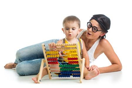 mother and kid boy play with counter toy photo