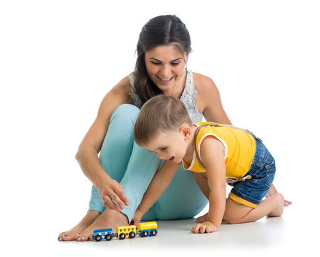 child boy and his mother play with toy photo