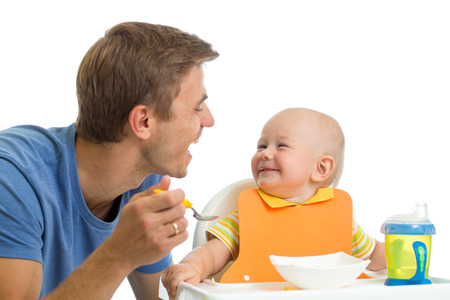 father feeding baby son