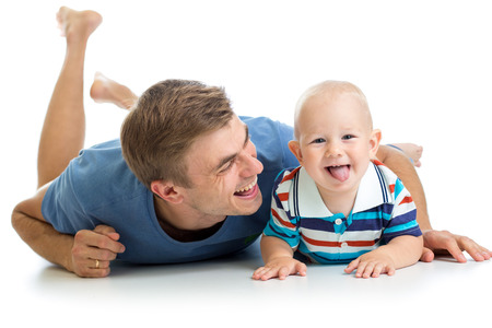 happy father and baby son having fun pastime photo