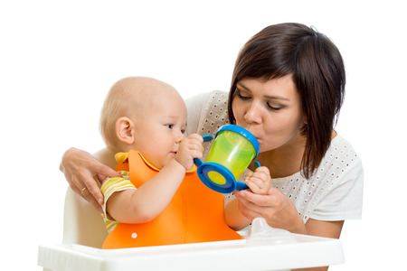 1 2 month: kid giving to mom water from his feeding cup