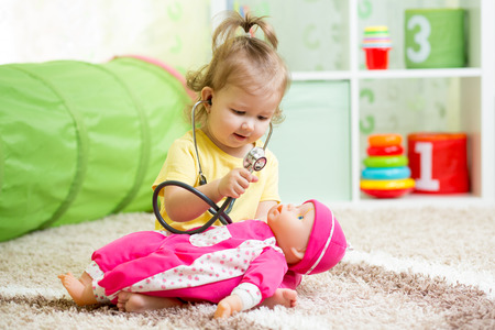 doctor toys: child playing doctor with toy Stock Photo