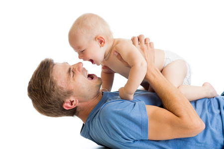 happy father and baby playing together photo