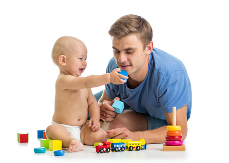 kid boy and father playing together photo