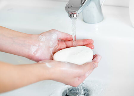 washing hand: Washing of female hands with soap in bathroom