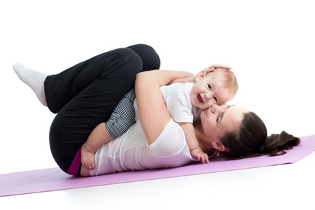 gymnastics girl: mom with child do gymnastic and fitness exercises Stock Photo