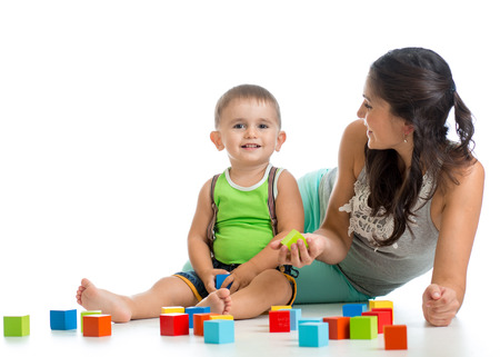 two parents: kid boy and mother playing together with construction set toy