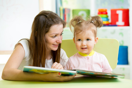 mom and kid read a book photo