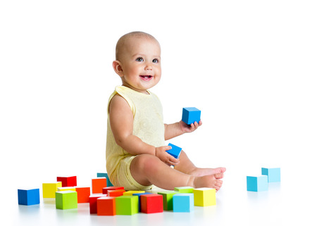 assiduous: baby playing with building block toys