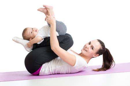 mother with child do gymnastic and fitness exercises photo