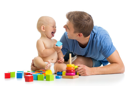 funny baby boy and father playing together