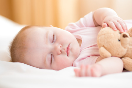 plush toy: infant baby sleeping Stock Photo