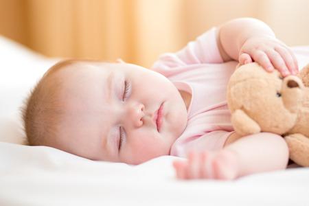 plush toy: infant baby sleeping Stock Photo