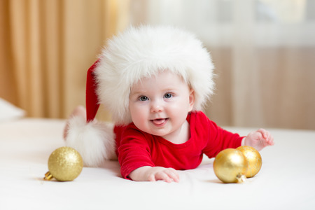 funny baby girl weared in Santa hat photo