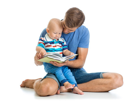 babyboy: Babyboy and his dad read a book Stock Photo