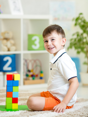 game block: kid playing with building blocks at home or kindergarten