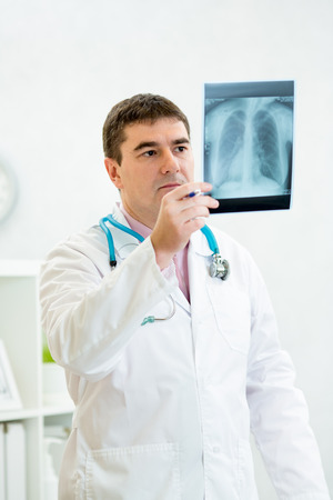 bronchitis: Doctor examining a lung radiography Stock Photo